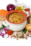 healthy soup with lentils and vegetables on a white background Stock Photos