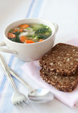 Healthy soup with wholemeal bread Stock Images