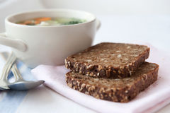 Healthy soup with wholemeal bread Royalty Free Stock Photos