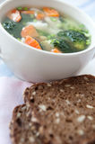 Healthy soup with wholemeal bread Stock Photos