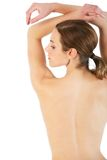Healthy spa look. Young woman poses showing off her lovely profile and back Stock Photo