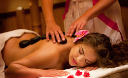 Healthy Spa: Young Beautiful Relaxing Woman Having Stone Massage Royalty Free Stock Photography