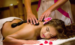 Healthy Spa: Young Beautiful Relaxing Woman Having Stone Massage Royalty Free Stock Image