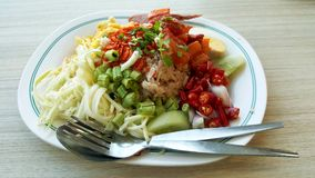 Kao klook kapi Thai dish menu. Healthy and spicy salad dish. Various vegetables and ingredients such as slice omelet, yard long bean and cucumber. Name's Kao Stock Photos
