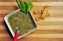 Healthy spinach oats soup on wooden background Stock Photography