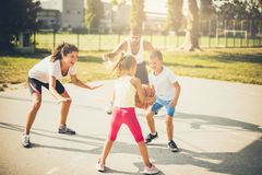 Healthy sport for family. Family playing basketball together royalty free stock photos