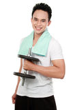 Healthy sports man with dumbbell smiling royalty free stock photography