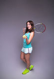 Healthy sporty girl with tennis racket and ball Stock Image