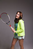 Healthy sporty girl with tennis racket Stock Images