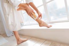 Healthy sporty woman putting her leg on windowsill Royalty Free Stock Photos