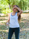 Healthy and Sporty Young Woman Drinking Water from Stock Images