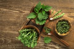 Healthy spring food with nettle and dandelion stock photo