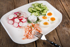Salad with eggs, cucumber, radishes and shripms Stock Photo