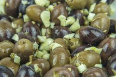Different types of olives and garlic stock image