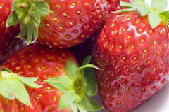 Healthy strawberries. Several tasty red strawberries over white background Stock Photography