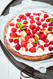 Healthy strawberry and banana tart with cream Stock Photo