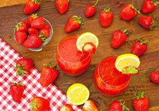 Healthy strawberry juice. With fresh strawberries and lemon Stock Image