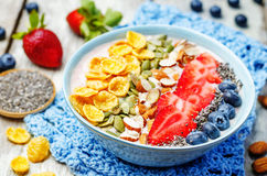 Healthy strawberry smoothie bowl with fruits, cereals, seeds and Stock Image
