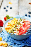 Healthy strawberry smoothie bowl with fruits, cereals, seeds and Stock Images