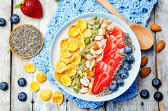 Healthy strawberry smoothie bowl with fruits, cereals, seeds and Royalty Free Stock Photos