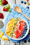Healthy strawberry smoothie bowl with fruits, cereals, seeds and Stock Photo