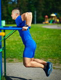 Healthy strong athlete man exercising at the city park Stock Photography