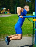 Healthy strong athlete man exercising at the city park Royalty Free Stock Image