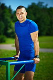 Healthy strong athlete man exercising at the city park Royalty Free Stock Images
