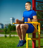 Healthy strong athlete man exercising at the city park Royalty Free Stock Photo