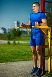 Healthy strong athlete man exercising at the city park Stock Photo