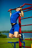 Healthy strong athlete man exercising at the city park Royalty Free Stock Photography