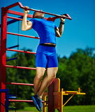 Healthy strong athlete man exercising at the city park Stock Images
