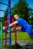Healthy strong athlete man exercising at the city park Stock Image