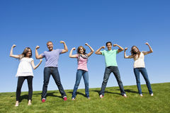 Healthy and Strong Young Adults. Five young adults displaying a healthy and strong image. A multi-ethnic group is represented in this photo Stock Image