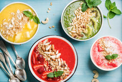 Healthy Summer Breakfast Concept. Colorful Fruit Smoothie Bowls On Turquoise Blue Background Stock Image