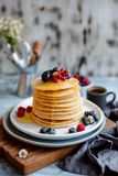 Healthy summer breakfast. Homemade classic american pancakes with fresh berries and honey. stock images