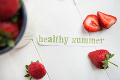 Healthy Summer Letters cut out from the Magazine, Strawberries Stock Images