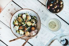 Healthy summer lunch with potato salad, olives and white wine royalty free stock photos