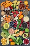 Healthy Super Food Choice. With fruit, vegetables, herbs, spices, pulses, himalayan salt and olive oil on marble background. Super foods high in vitamins, fibre royalty free stock photos