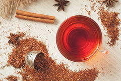 Healthy superfood beverage rooibos african tea. Rooibos traditional organic dieting drink. Healthy superfood beverage rooibos african tea with spices on vintage Stock Images