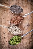 Healthy superfood: pumpkin seeds, sunflower seeds, flax seeds and chia Royalty Free Stock Image