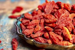 Healthy superfood, red dried goji chinese wolfberry berries, used in many snack foods and supplements, granola bars, yogurt, tea. Blends, fruit juice as whole royalty free stock image