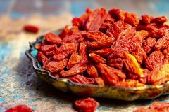 Healthy superfood, red dried goji chinese wolfberry berries, used in many snack foods and supplements, granola bars, yogurt, tea. Blends, fruit juice as whole royalty free stock photography
