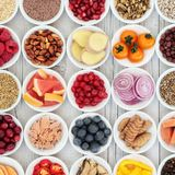 Healthy Superfood Selection. With fresh fruit, vegetables, fish, seeds, nuts, spice and herbs with foods high in omega 3 fatty acids, antioxidants, anthocyanins royalty free stock photos