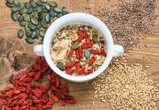 Healthy superfoods. Oatmeal muesli goji berries linseed Royalty Free Stock Images