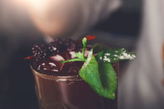 Healthy sweet berry cocktail with mint Stock Images