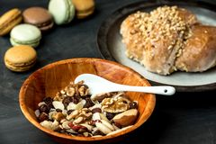 Healthy, sweet homemade pie, nuts and macaroons. Pie with apples and nuts surrounded by nuts and macaroons on a dark, rustic table stock images