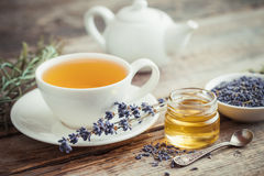 Healthy tea cup, jar of honey, dry lavender and teapot Stock Photography