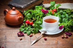 Healthy tea with a dogrose on wooden table Stock Photos