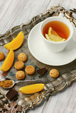 Healthy tea with lemons, chocolate and cookies Stock Photo